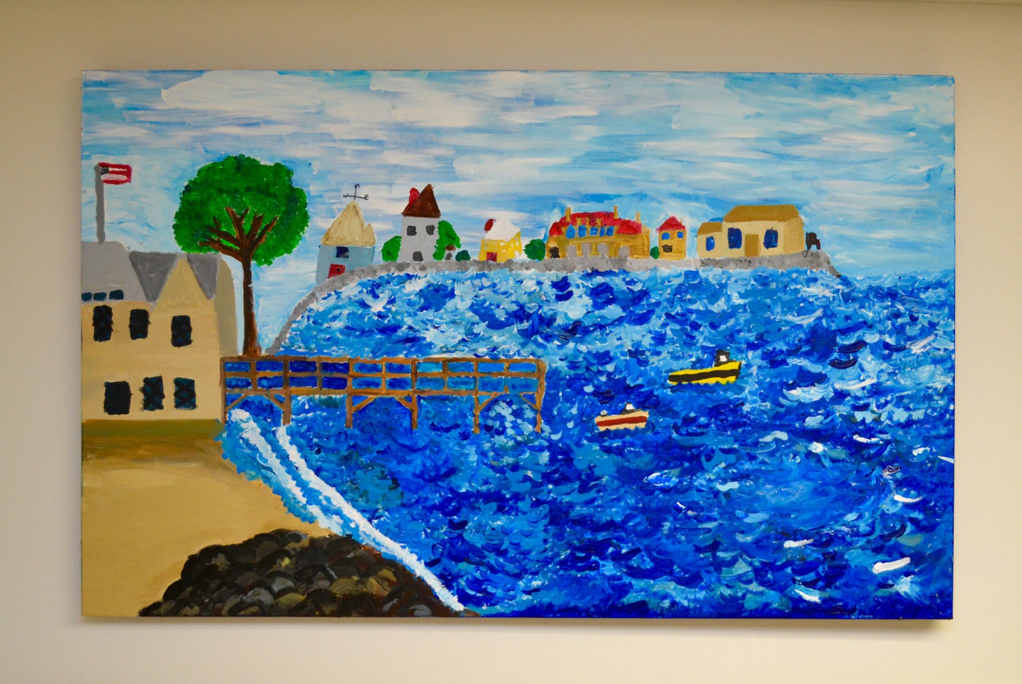 Stanley artwork of the ocean with boats and houses